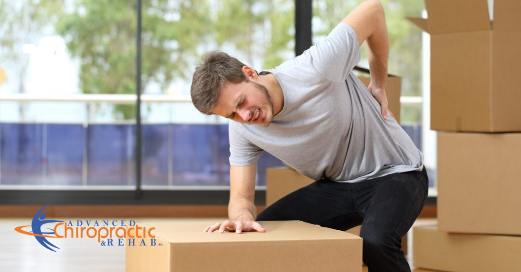 Man with Back pain moving box